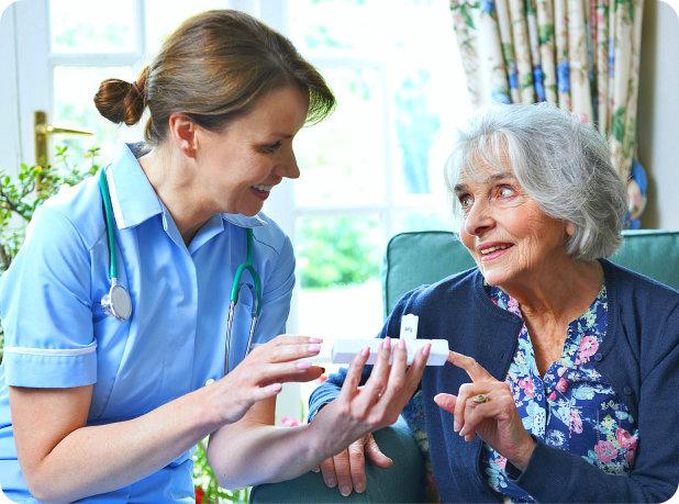 happy senior woman and a nurse