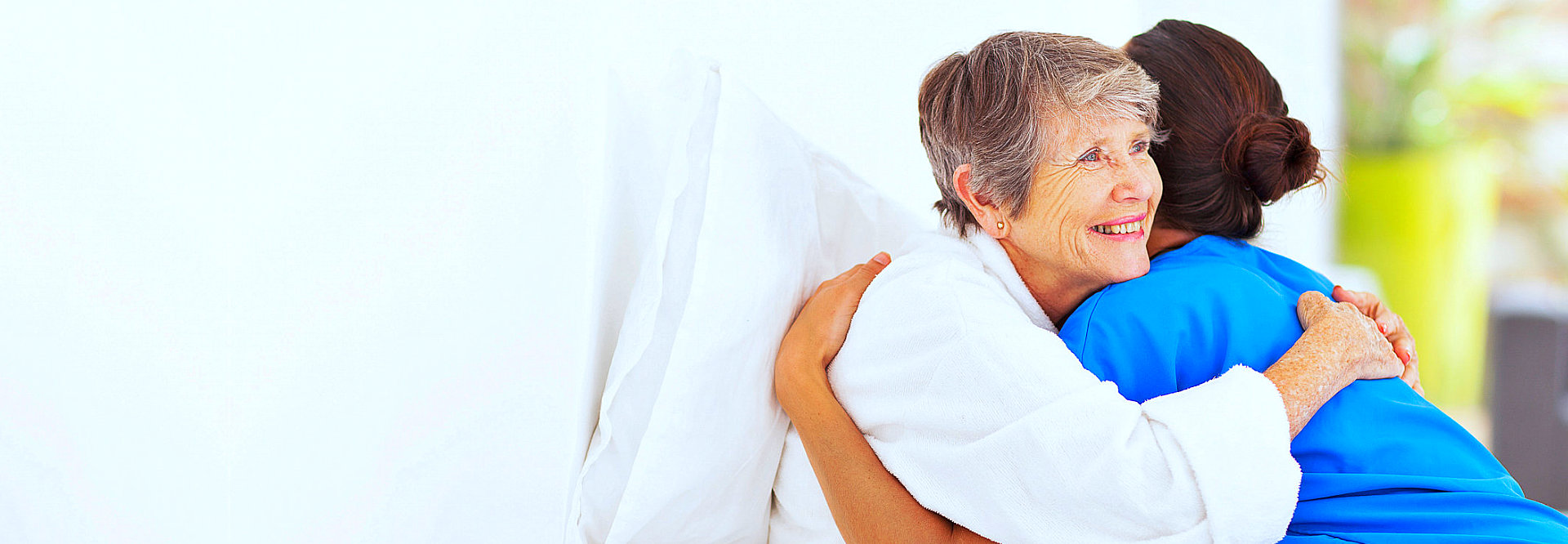 senior woman happy while hugging to her nurse
