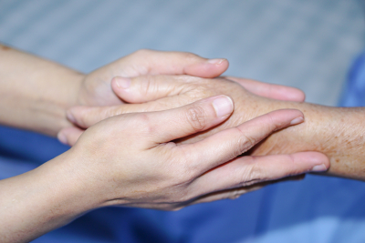 holding touching hands to senior a caring concept