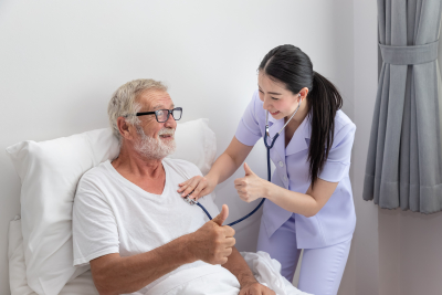nurse use stethoscope to examine elderly man health in bedroom