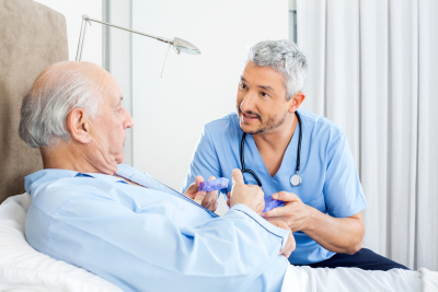 male nurse caring senior man